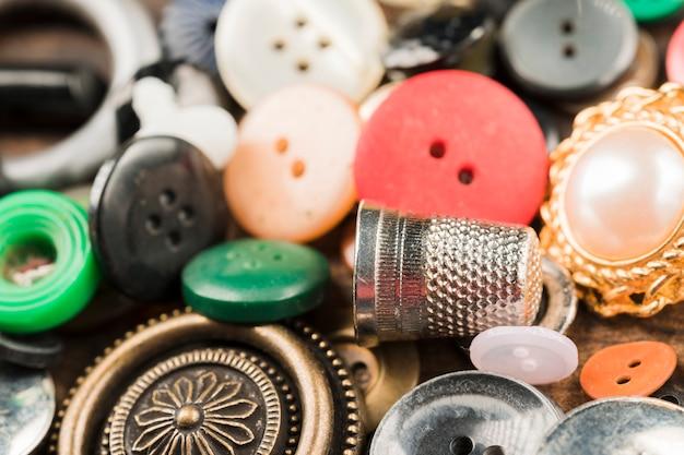 Botões de costura com dedal