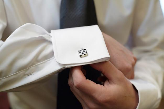 Botões de punho do noivo