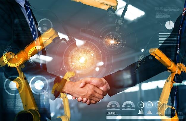 Braço de robô mecanizado da indústria e dupla exposição de aperto de mão de negócios