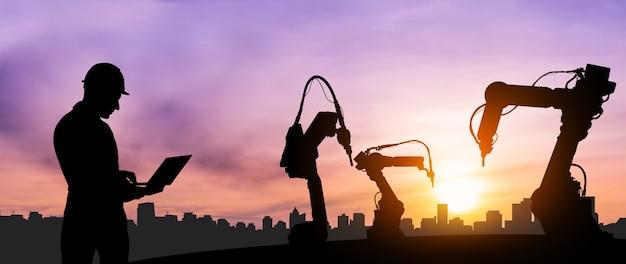 Braços robóticos mecanizados da indústria na futura fábrica