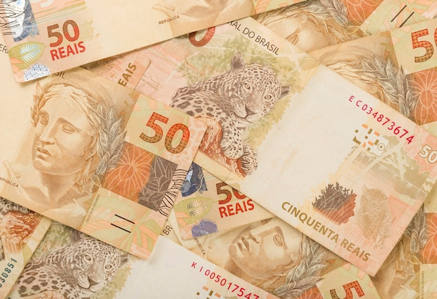 Brazillian money, 50 reais notas background pattern.