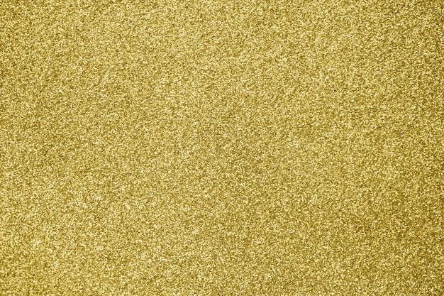 Brilho abstrato de glitter dourado