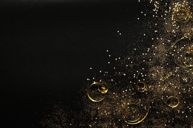 Brilhos dourados e fitas em preto