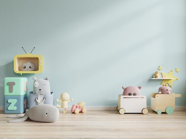 Brinquedos do quarto de crianças no fundo da parede azul.