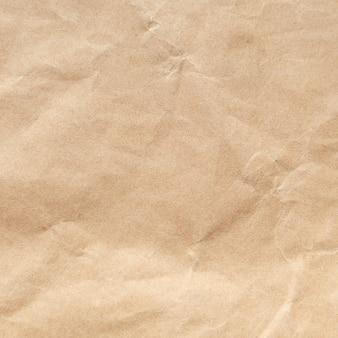 Brown amarrotou o fundo de papel da textura.