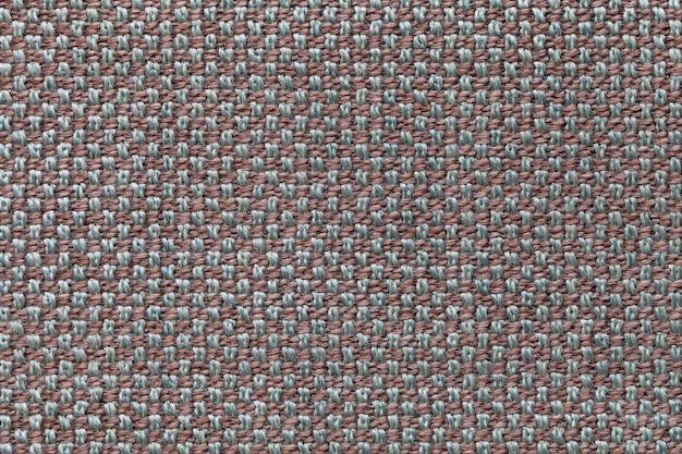 Brown e fundo cinzento de matéria têxtil com teste padrão da xadrez, close up. estrutura da macro de malha.