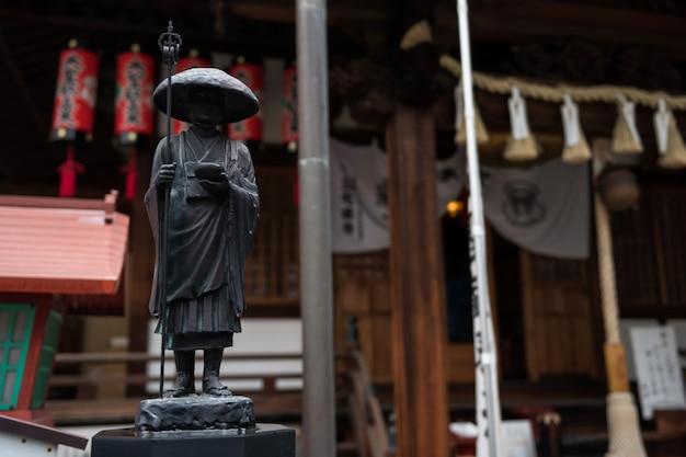 Budista, estátua, monge, segurando, vara