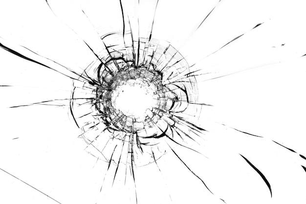 Buraco de uma bola no vidro, rachaduras em um fundo branco