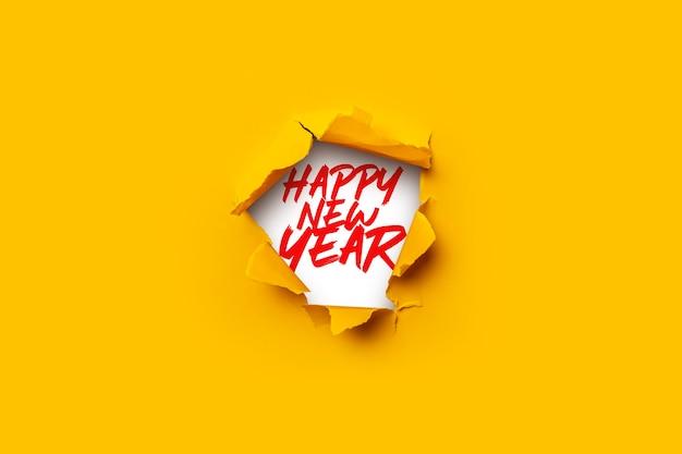 Buraco na parede e texto de saudação ano novo e feliz natal.