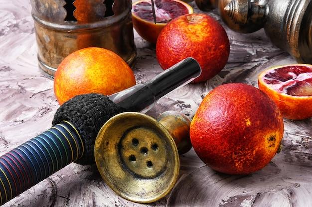 Cachimbo narguilé oriental com sabor a laranja