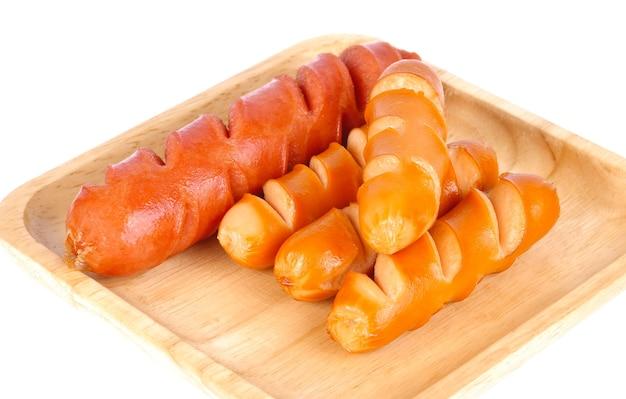 Cachorro-quente frito em bandeja de madeira