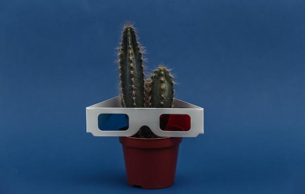 Cacto em uma panela com óculos 3d no fundo azul clássico
