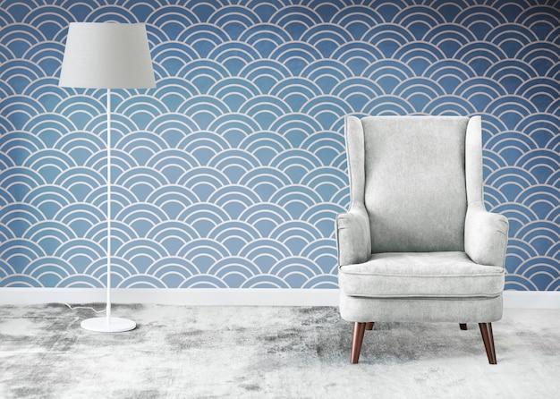 Cadeira cinzenta com encosto em asa em uma maquete de sala