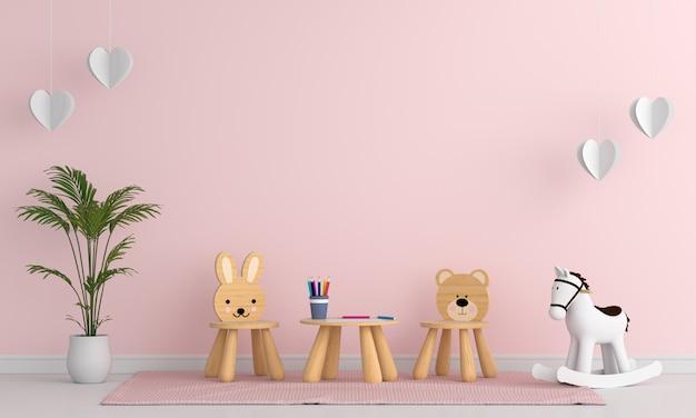 Cadeira e mesa no interior do quarto de criança rosa