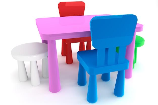 Cadeiras e mesa infantis de plástico coloridas em um fundo branco