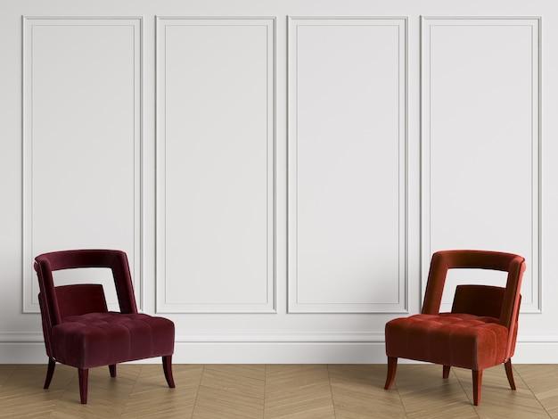 Cadeiras em diferentes cores vermelhas no interior clássico com espaço de cópia. paredes brancas com molduras. espinha de peixe em parquet. renderização em 3d