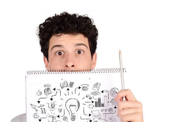 Caderno de exploração de estudante com esboço de ideia