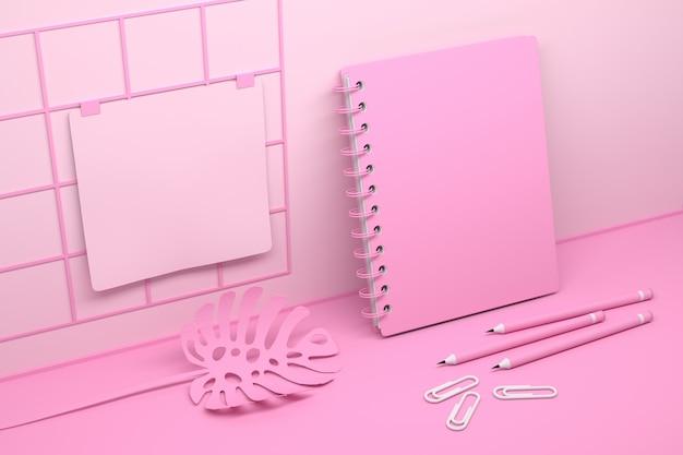 Caderno espiral rosa e planta mostera
