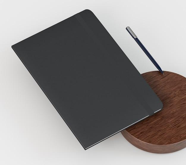 Caderno preto e papelaria corporativa em branco