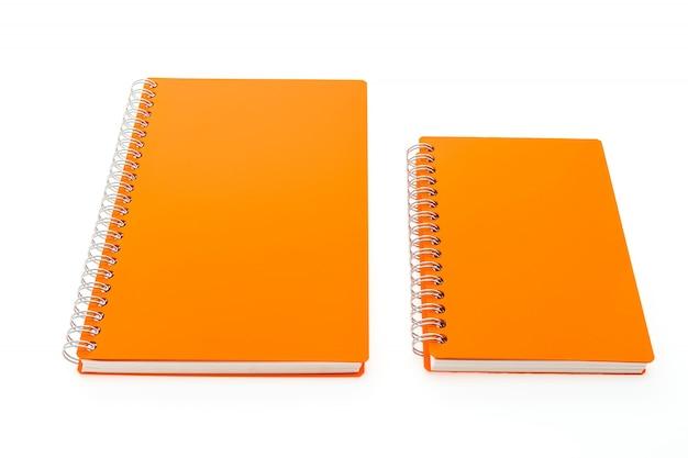 Cadernos alaranjadas com anéis
