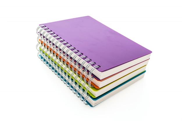 Cadernos coloridos empilhados