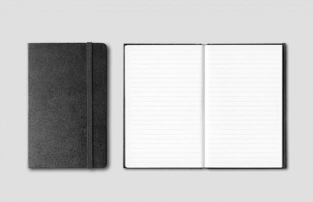 Cadernos fechados e abertos pretos isolados em cinza