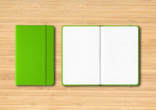 Cadernos verdes fechados e abertos