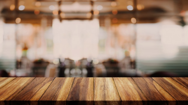 Cafetaria ou café interior do borrão abstrato para o fundo.