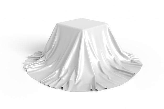 Caixa coberta com tecido branco.