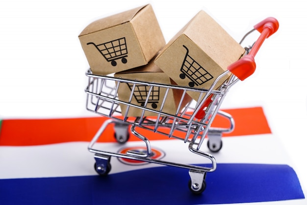 Caixa com logotipo de carrinho de compras na bandeira da holanda