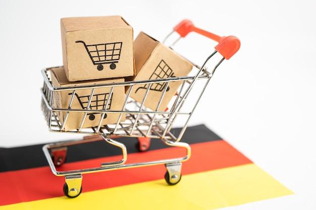Caixa com logotipo do carrinho de compras e bandeira da alemanha import export shopping online