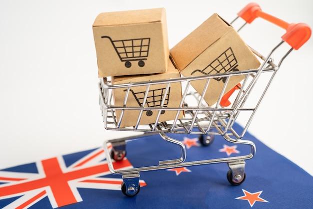 Caixa com logotipo do carrinho de compras e bandeira da nova zelândia. import export shopping online