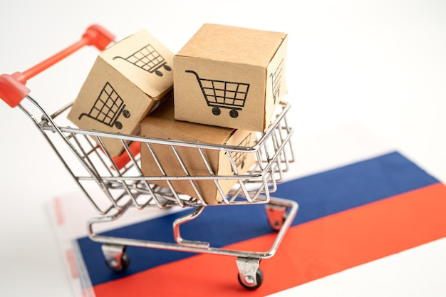 Caixa com logotipo do carrinho de compras e bandeira da rússia. import export shopping online