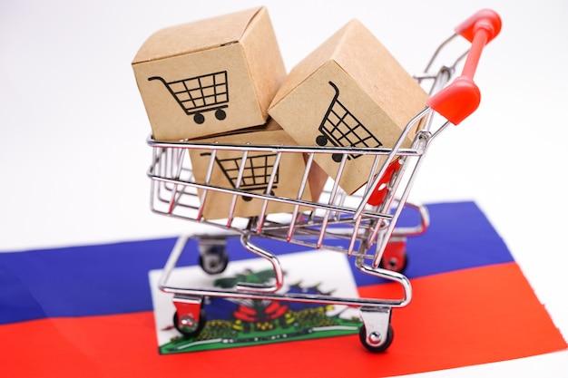 Caixa com logotipo do carrinho de compras e bandeira de halti.