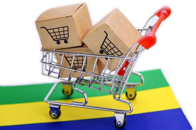 Caixa com logotipo do carrinho de compras e bandeira do gabão.