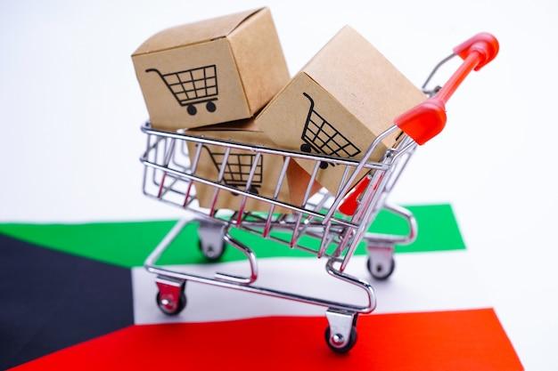 Caixa com logotipo do carrinho de compras e bandeira do kuwait.