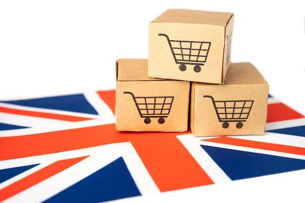 Caixa com logotipo do carrinho de compras na bandeira do reino unido