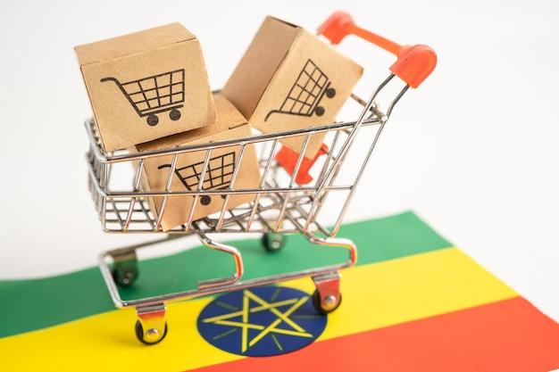 Caixa com o logotipo do carrinho de compras e a bandeira da etiópia, importação, exportação, compras on-line ou serviço de entrega de finanças de comércio eletrônico, envio de produtos, comércio, conceito de fornecedor.