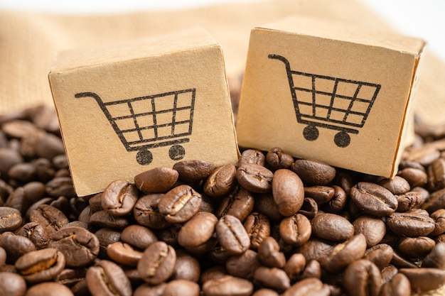 Caixa com o símbolo do logotipo do carrinho de compras em grãos de café importação exportação compras online