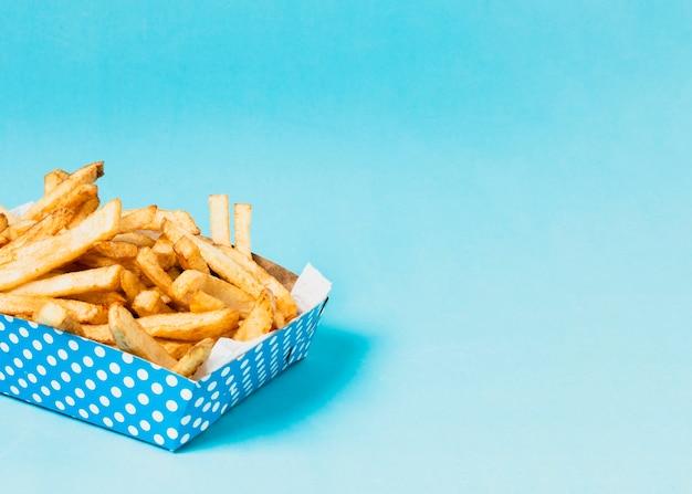 Caixa de batatas fritas com espaço de cópia