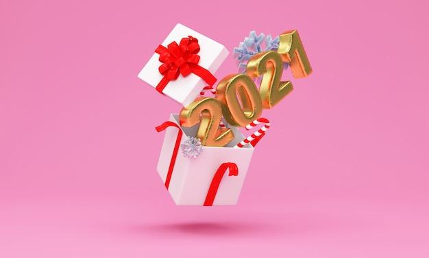 Caixa de presente aberta com o símbolo dourado do ano novo e flocos de neve rosa