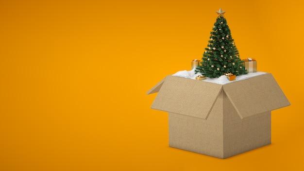 Caixa de presente aberto com uma árvore de natal e neve