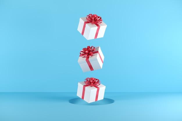 Caixa de presente branca com cor de fita vermelha flutuando sobre fundo azul