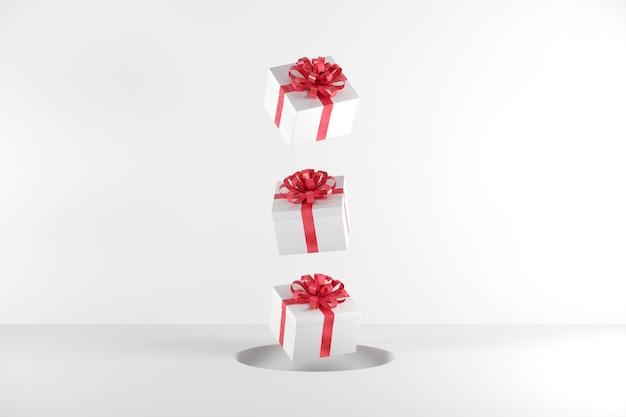 Caixa de presente branca com fita vermelha cor flutuando no fundo branco
