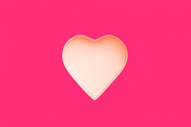 Caixa de presente coração rosa para dia dos namorados em um fundo rosa.