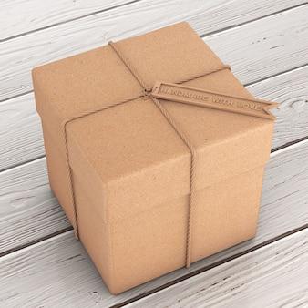 Caixa de presente de papelão com corda e etiqueta de artesanato de madeira com sinal artesanal com amor em uma mesa de madeira. renderização 3d