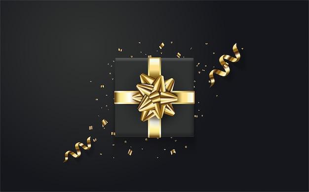 Caixa de presente preta com uma elegante fita de ouro