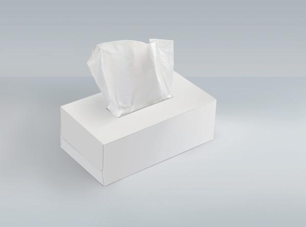 Caixa de tecido branco em branco sobre fundo azul claro com tecido facial