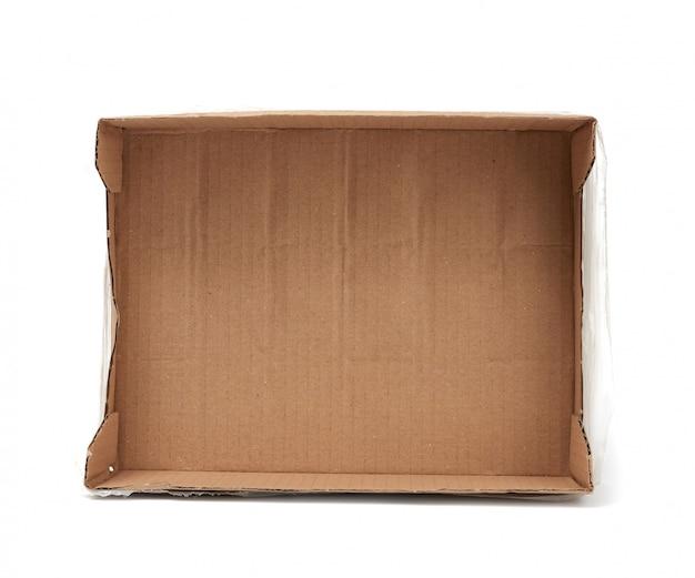 Caixa retangular vazia de papel cartão marrom com celofane transparente para transporte de garrafas