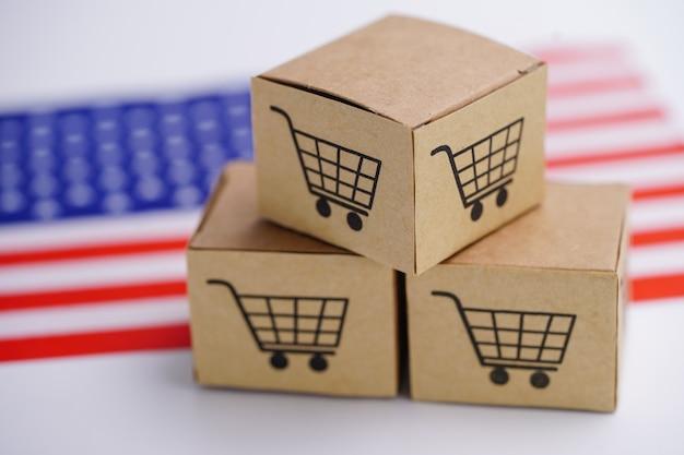 Caixas com logotipo de carrinho de compras e a bandeira do eua.